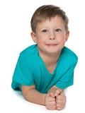 Nachdenklicher Junge auf dem weißen Hintergrund stockbild