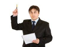 Nachdenklicher moderner Geschäftsmann mit Notizbuch erhielt Idee Stockbild