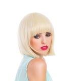 Nachdenkliches blondes nettes Mädchen, das weg schaut Lizenzfreie Stockfotografie