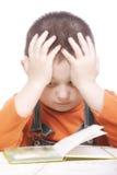 Nachdenkliches Kindlesebuch Lizenzfreies Stockfoto