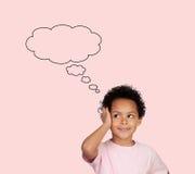Nachdenkliches lateinisches Kind Lizenzfreies Stockfoto