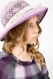 Nachdenkliches Mädchen in einem Hut Stockbild