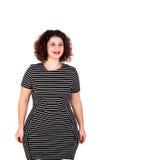 Nachdenkliches schönes curvy Mädchen mit gestreiftem Kleid lizenzfreies stockbild