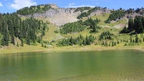 Naches Peak on Upper Tipsoo Lake stock footage