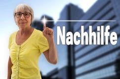 Nachhilfe (in german tutoring) touchscreen is shown by senior stock photo