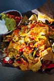 Nacho basket with cheese royalty free stock images