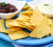 Nacho chips. A snack of mexican nacho chips with dips Stock Images