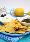 Nacho chips. A snack of mexican nacho chips with dips Royalty Free Stock Photos