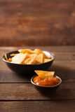 Nacho chips. Mexican nacho chips and salsa dip in bowl on wooden background Royalty Free Stock Photography