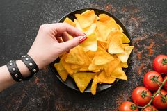 Nacho chips recipe natural food woman slice plate Stock Photography