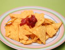 Nacho chips with salsa sauce. Some fresh nacho chips with salsa sauce Royalty Free Stock Image