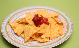 Nacho chips with salsa sauce. Some fresh nacho chips with salsa sauce Stock Photos