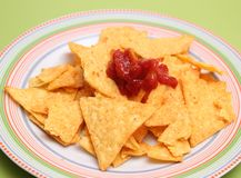 Nacho chips with salsa sauce. Some fresh nacho chips with a salsa dip Stock Photos