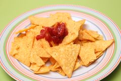 Nacho chips with salsa sauce. Some fresh nacho chips with a salsa dip Royalty Free Stock Photos