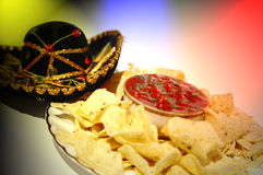 Nacho fiesta. Nacho chips, salsa, and sombrero Stock Photos