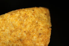 Nacho isolated. Mexican nacho close up isolated in black background Royalty Free Stock Photos
