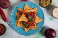 Nacho, pasto messicano con i chip di tortiglia Immagini Stock