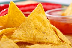 Nacho snacks. With salsa dip closeup Stock Photography