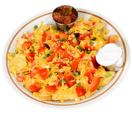 Nachos. A plate of nachos and cheese, isolated on a white background Royalty Free Stock Photo