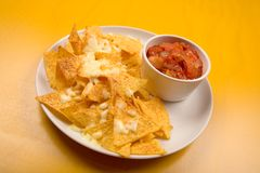 Nachos. With salsa dip on a white plate Royalty Free Stock Photos