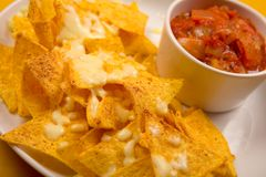 Nachos. With salsa dip on a white plate Stock Images