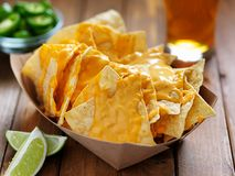 Free Nachos And Cheese In Tray With Beer Stock Photo - 143864040