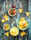 Nachos and assorted dips royalty free stock photos