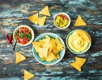 Nachos and assorted dips royalty free stock photography