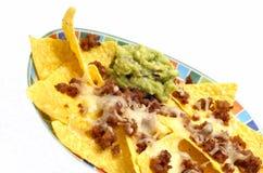 Nachos and avocado dip. Nachos with avocado dip, cheese and bacon royalty free stock photography