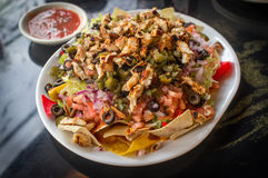Nachos chargés par Mexicain Photos stock