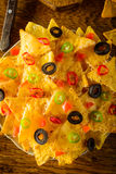 Nachos with cheese, olives and chili Royalty Free Stock Photos