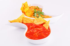 Nachos, cheese and red sauce Stock Photos
