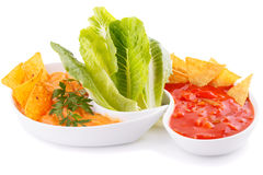Nachos, cheese and red sauce,  vegetables Stock Photo