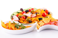 Nachos, cheese and red sauce,  vegetables Royalty Free Stock Images