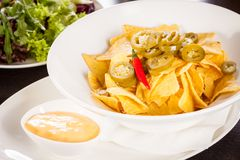 Nachos with cheese sauce and chilli pepperoni Royalty Free Stock Photo