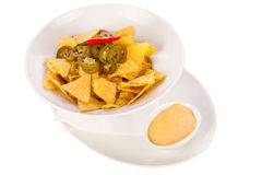 Nachos with cheese sauce and chilli pepperoni Stock Photo
