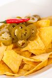 Nachos with cheese sauce and chilli pepperoni Royalty Free Stock Photography