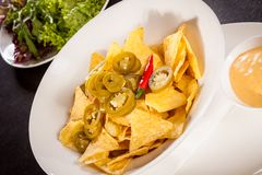 Nachos with cheese sauce and chilli pepperoni Royalty Free Stock Image
