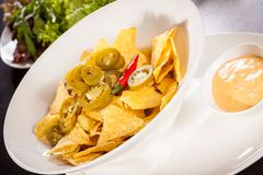Nachos with cheese sauce and chilli pepperoni Stock Image