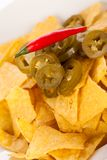 Nachos with cheese sauce and chilli pepperoni Stock Photos