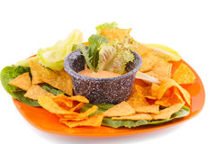 Nachos and cheese sauce Stock Images