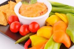 Nachos, cheese sauce,  vegetables Stock Photos