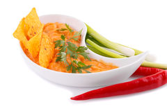 Nachos, cheese sauce,  vegetables Stock Image
