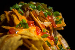 Nachos. Cheese Nachos served with garlic souce and spring onion royalty free stock photos