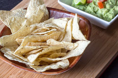 Nachos chip. With guacamole on table royalty free stock image