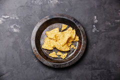 Nachos chips on metal plate Stock Image