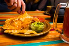Nachos chips from Mexican cuisine. With sauces on the table stock photography