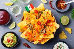 Nachos chips with Mexican flag and dips variety royalty free stock photo