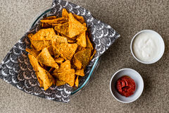 Nachos chips with salsa and sour cream dips / Yogurt Sauce. Stock Photo