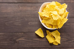 Nachos chips on wooden background. Top view Royalty Free Stock Image